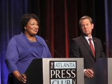 Stacey Abrams and Brian Kemp in a debate for the 2018 midterms